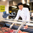 Fresh Meat Counter with Butcher — Stock Photo #5735502