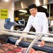 Fresh Meat Counter with Butcher — Stock Photo