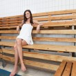 Pretty Caucasian woman sitting on a bench — Stock Photo #5735579