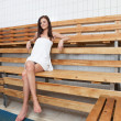 Pretty Caucasian woman sitting on a bench — Stock Photo