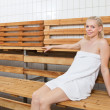 Royalty-Free Stock Photo: Young blond woman relaxing in sauna