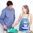Happy mature couple with painting tools — Stock Photo