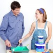 Happy mature couple with painting tools - Stockfoto