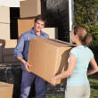Couple carrying box into the truck — Stock Photo #5735810