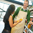 Helpful Grocery Store Clerk — Stock Photo