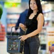 Happy Asian Female Shopper — Stock Photo
