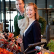 Supermarket Woman and Clerk — Stock Photo #5736660