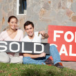 Happy young couple with key to their new house — Stock Photo #5736937