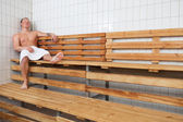Mature man relaxing in steam room — Stock Photo