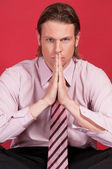 Thoughtful businessman with hand clasped — Stock Photo