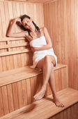 Young woman resting in sauna — Stock Photo