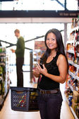 Asian Woman in Supermarket — Stock Photo