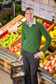 Portrait of serious man in shopping centre — Stock Photo