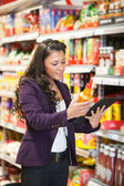 Online Product Comparison in Supermarket — Stock Photo