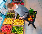 Male in Supermarket Buying Fruit — Stock Photo