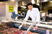 Fresh Meat Counter with Butcher — Stockfoto