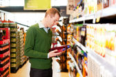 Male Shopping Comparing Products — Stock Photo