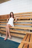 Pretty Caucasian woman sitting on a bench — Stock Photo