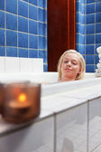 Beautiful young woman in bathtub with eyes closed — Stock Photo