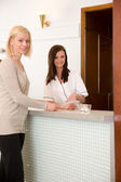 Woman in Spa Reception — Stock Photo