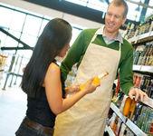 Helpful Grocery Store Clerk — Stock Photo
