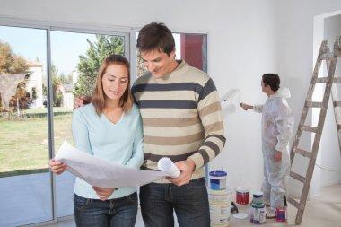Couple going through house plan