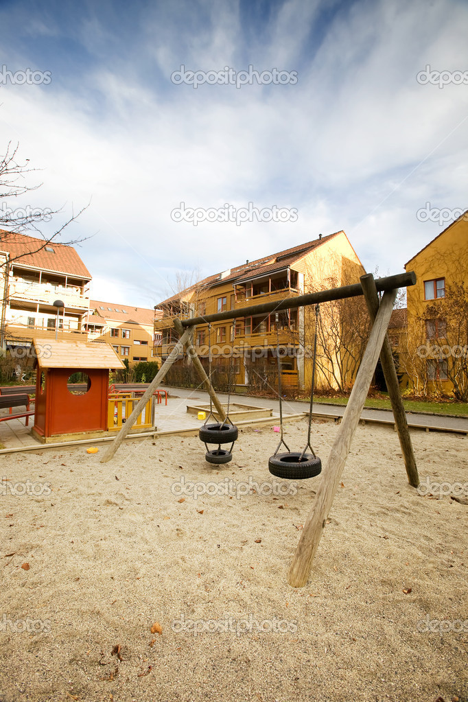 A swing set in a apartment block area — Stock Photo #5732793