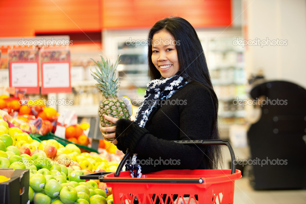 Portrait of a cheerful young woman buying fruits in the supermarket  Stock Photo #5732996