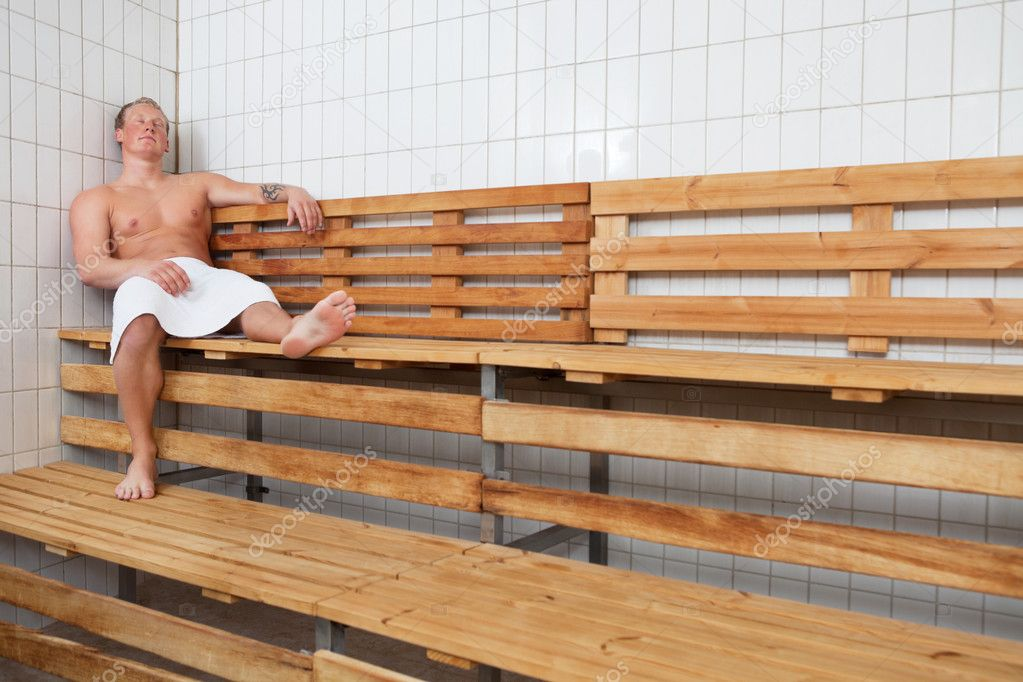 Mature man relaxing in steam room at a sauna spa — Stock Photo #5733681