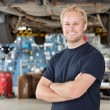 Portrait of Smiling Mechanic - Stockfoto