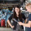 Happy Female Customer at Mechanic — Stock Photo
