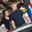 Angry woman with mechanic — Stock Photo