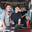 Portrait of garage worker and client — Stock Photo