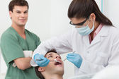 Dentist procedure of cleaning teeth — Stock Photo