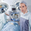 Male doctor confident while surgery — Stock Photo