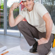 Smart young construction worker - Stock Photo