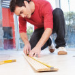 Architect measuring the plank — Stock Photo