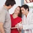 Young couple consulting the painter — Stock Photo