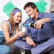 Smiling couple having champagne — Stock Photo