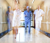 Team of doctor and nurse running — Stock Photo