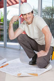 Smart young construction worker — Stock Photo