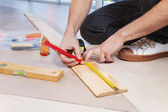 Man marking on plywood — Stock Photo