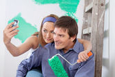 Happy couple taking a snapshot of themselves — Stock Photo
