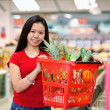 Asian Woman in Supermarket - Foto de Stock