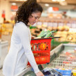 woman buying frozed food in supermarket — Stock Photo
