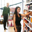 Portrait of a woman in grocery store — Stock Photo