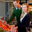 Portrait of Couple in Supermarket - Stock Photo