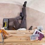 Man working under wooden plank — Stock Photo #6556052