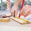 Engineer marking on plywood — Stock Photo
