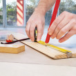 Engineer marking on plywood - Stock Photo